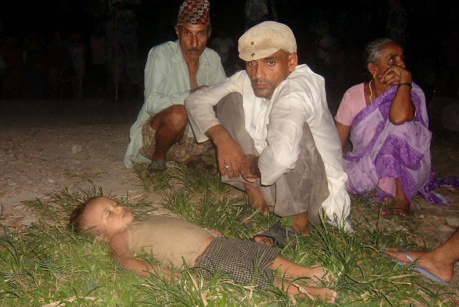 Difficult to bear: father sitting nearby his son who died by swallowing excessive water in a nearby river